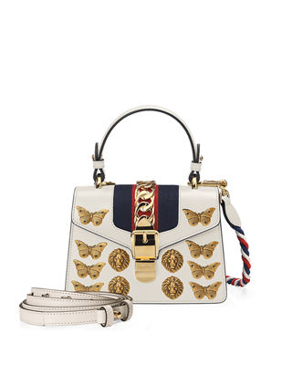 Sylvie Mini Embellished Chain-Trimmed Leather And Canvas Shoulder Bag in White