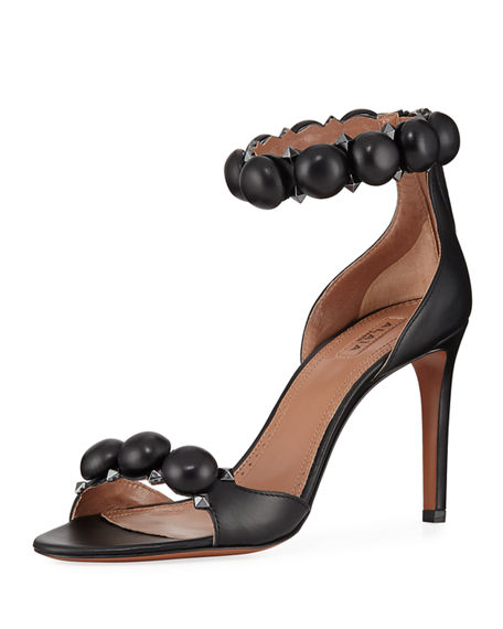 ALAÏA BOMBE STUD LEATHER ANKLE-WRAP SANDALS